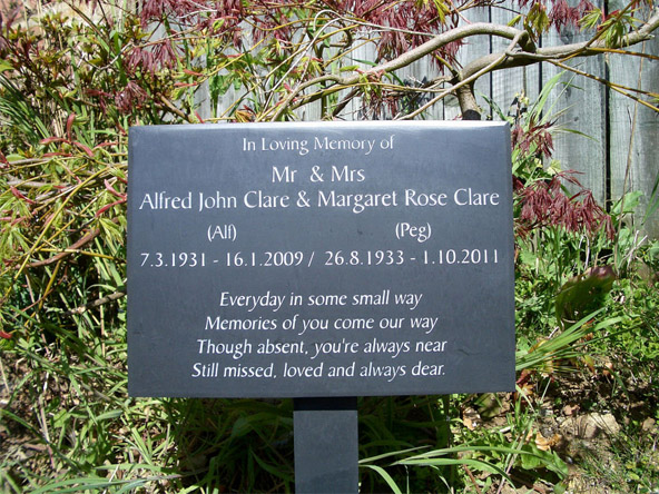 memorial plaque with a wooden stand