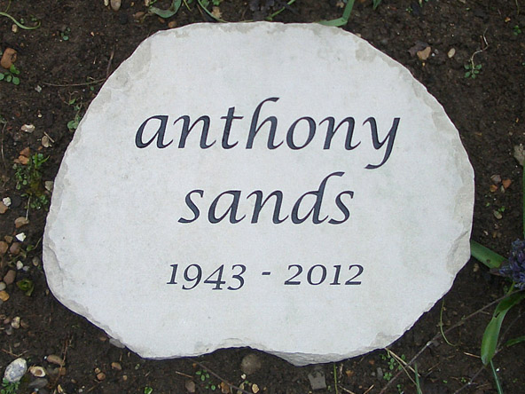plaque made using sandstone on garden flower bed