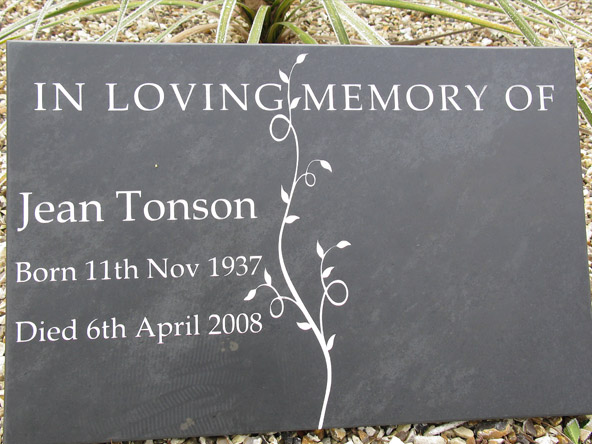 slate memorial plaque on gravel